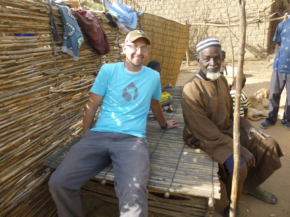 Mark takes a break from our work to visit with a village elder.