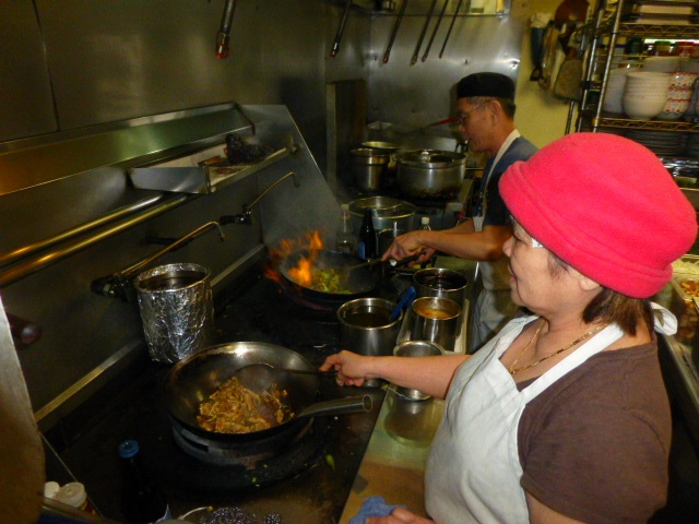 Our chief cooks Lee and Tro stir fry meals over our powerful jet wok range