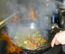 Delicious stir-fry dish in process