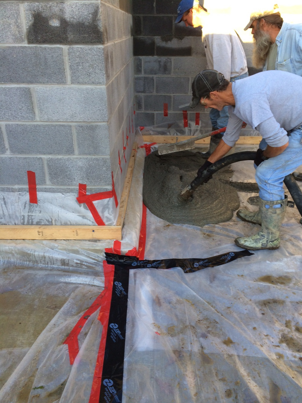 After the air barrier has been sealed, the masons pour the concrete slab