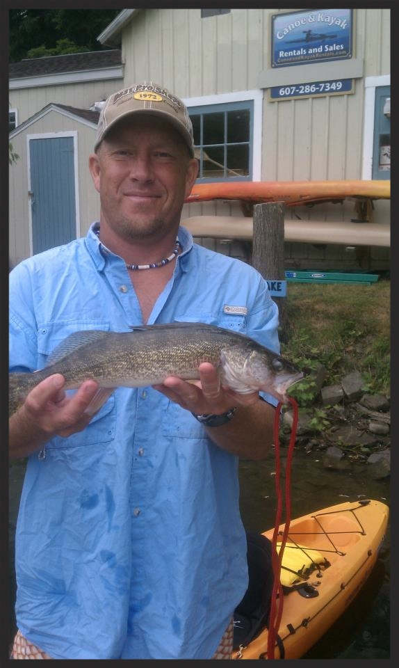 Happy customer with his first walleye. He used an angler kayak.