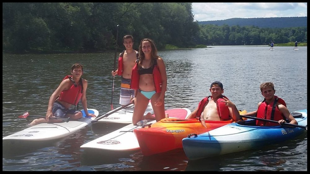 A group having a blast on the river. Smiles for miles!