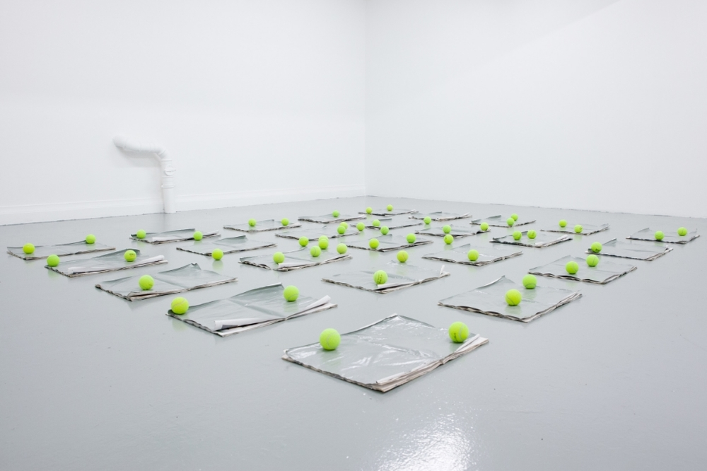 Untitled, 2015, Newspapers, paint, tennis balls, Various dimensions, site-specific installation, Courtesy the Artist and Galerie Antoine Levi, Paris