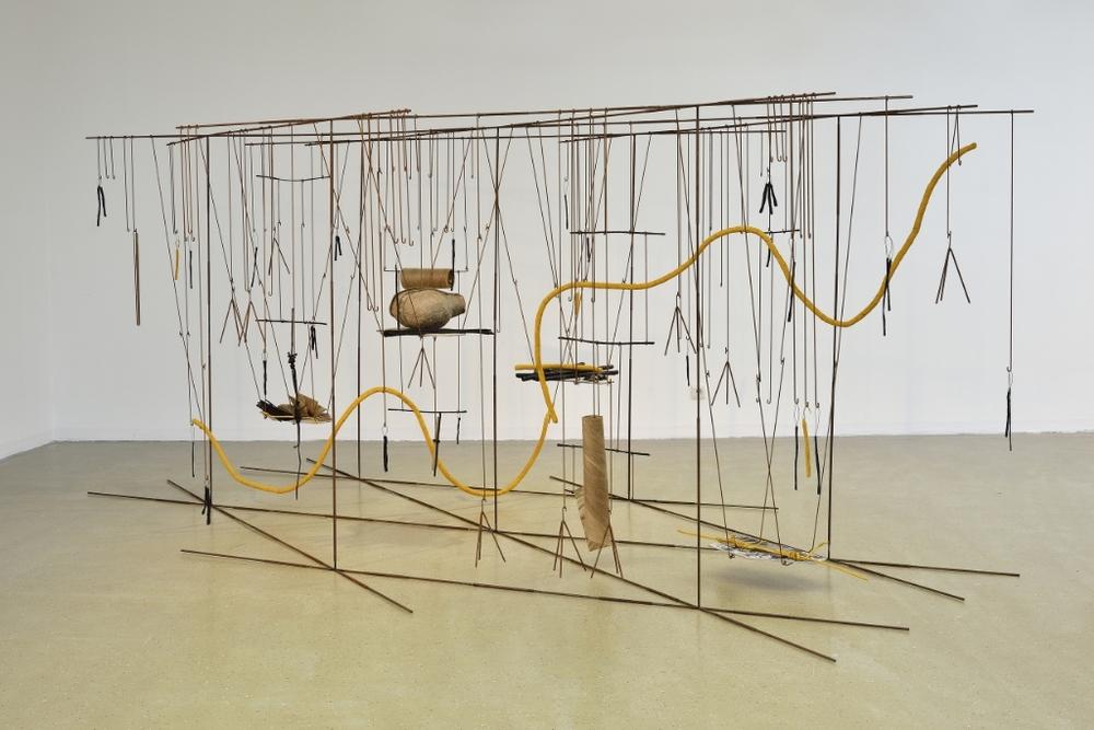 IZA TARASEWICZ, THE MEANS, THE MILIEU, 2014–15, STEAL, CAOUTCHOUC, CONCRETE, OCHER, REICHI, 250 X 450 X 190 CM