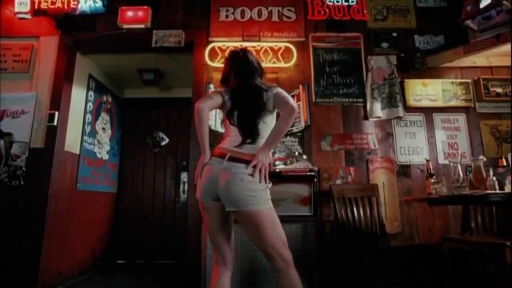 Title: Death Proof  Director: Quentin Tarantino  Year: 2007  Track: Down in Mexico (The Coasters)   https://www.youtube.com/watch?v=Kahp_kmOFzQ