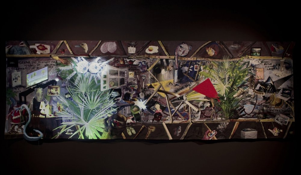 Since he is gone, weaved by Grand Ma,  2014 ;  tapestry, fabric, wood, spotlight and video component (02 min. 24 sec.); 195 x 580 cm; Courtesy the artist and Nathalie Obadia, Paris
