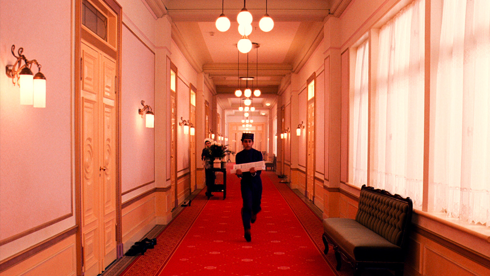 Title: The Grand Budapest Hotel   Director: Wes Anderson  Year: 2014  Track: Moonshine (Alexandre Desplat)      https://www.youtube.com/watch?v=H22fZWySJ50
