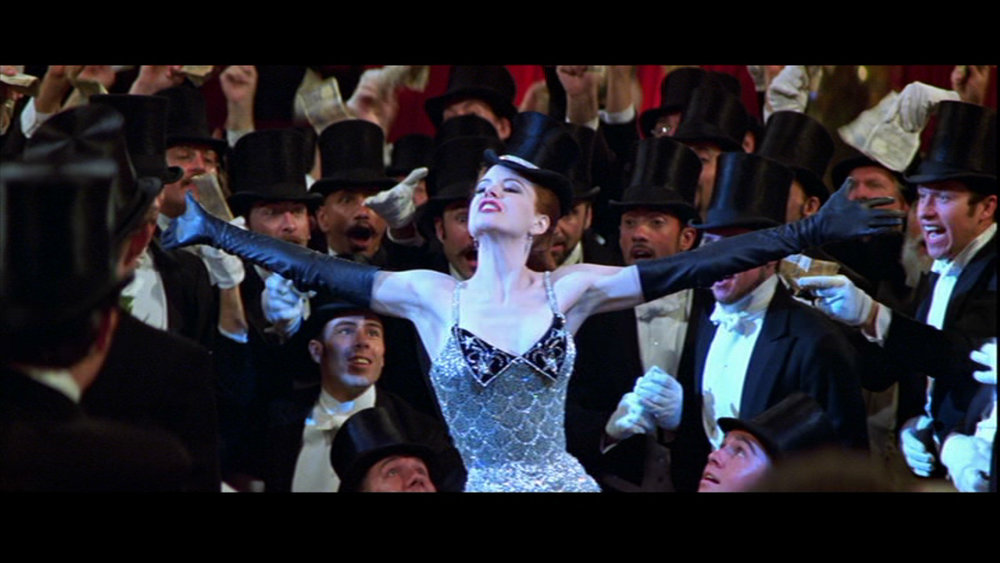 Title: Moulin Rouge  Director: Baz Lurhmann  Year: 2001  Track: Roxanne   https://www.youtube.com/watch?v=Rn0xXo1gwGY
