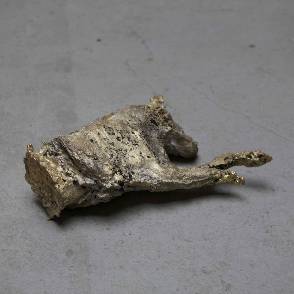 Jean-Marie Perdrix,  Chien à la chair perdue , 2013, Cast copper alloy, charcoal, bones and ashes, 39 x 32 x 14 cm