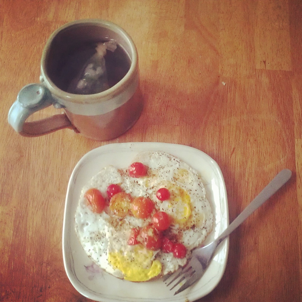 fried eggs with sautéed cherry tomatoes and nettle tea