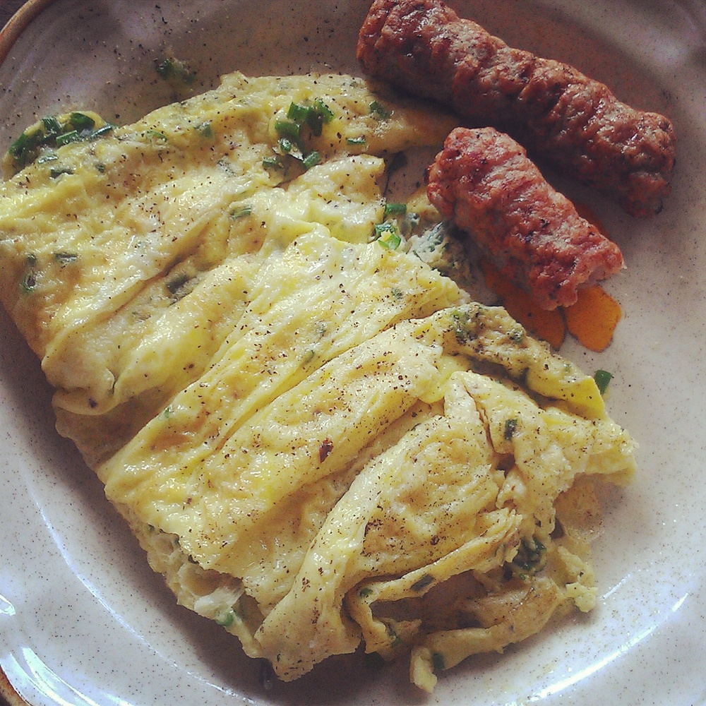 Omelet with parsley and sausage