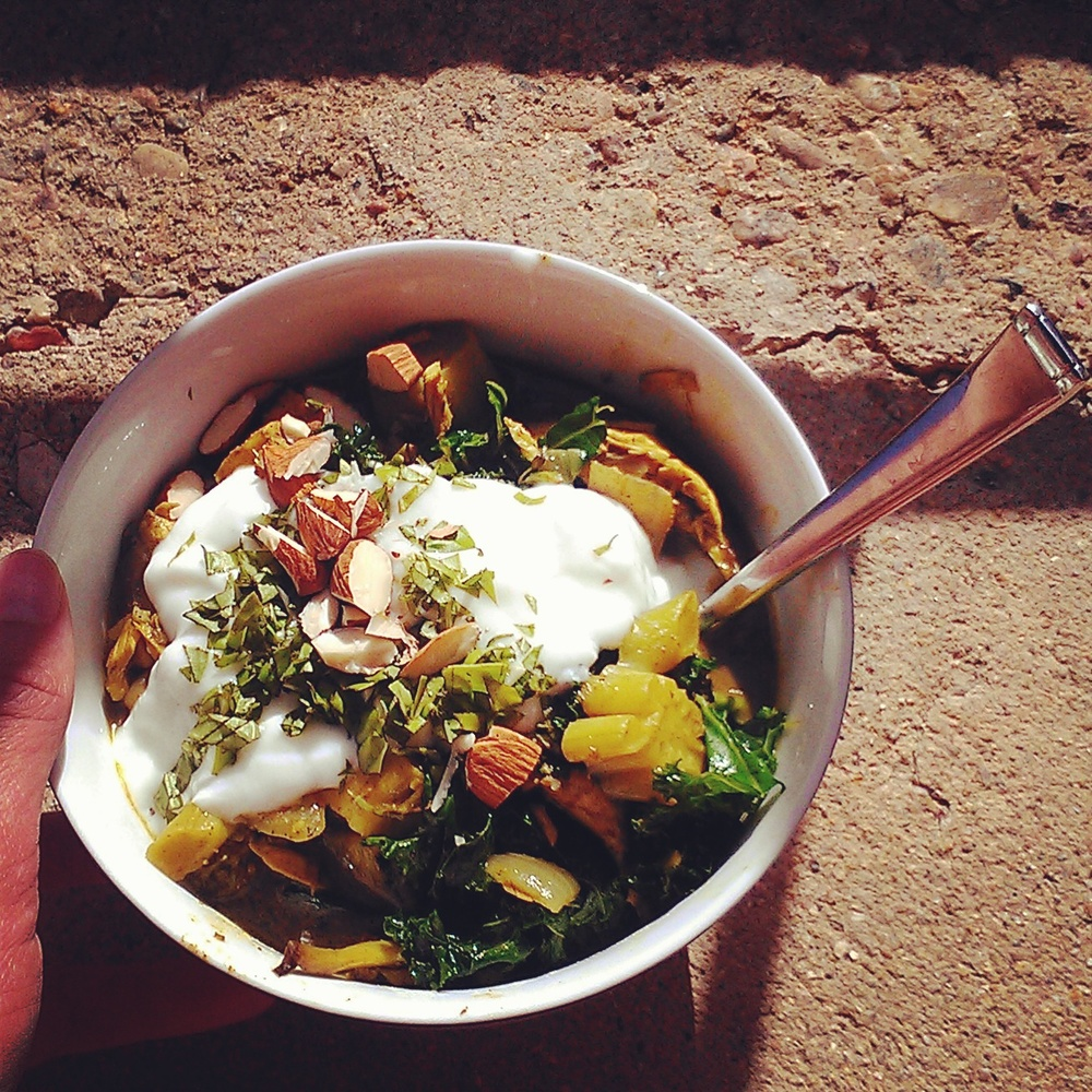 winter squash and kale topped with goat yogurt, chopped almonds and fresh herbs