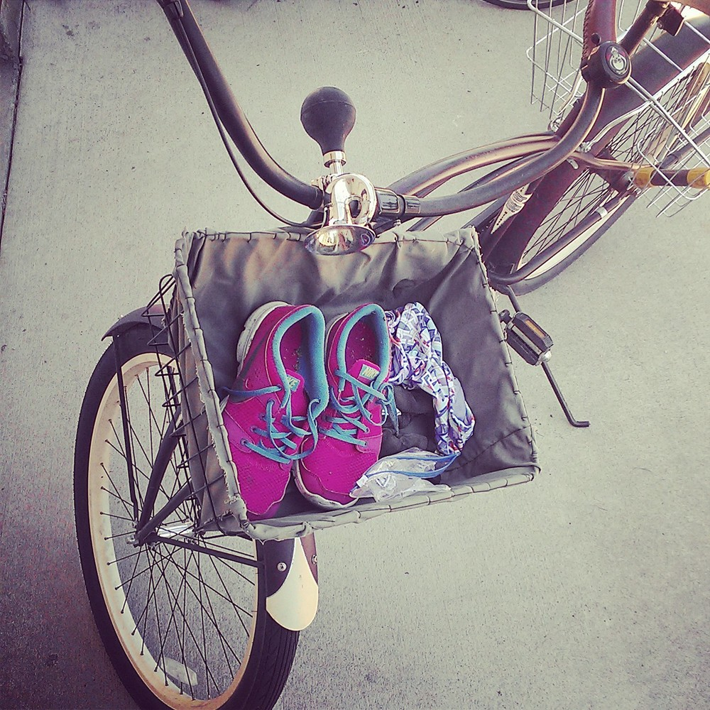 Running shoes in my bike basket.