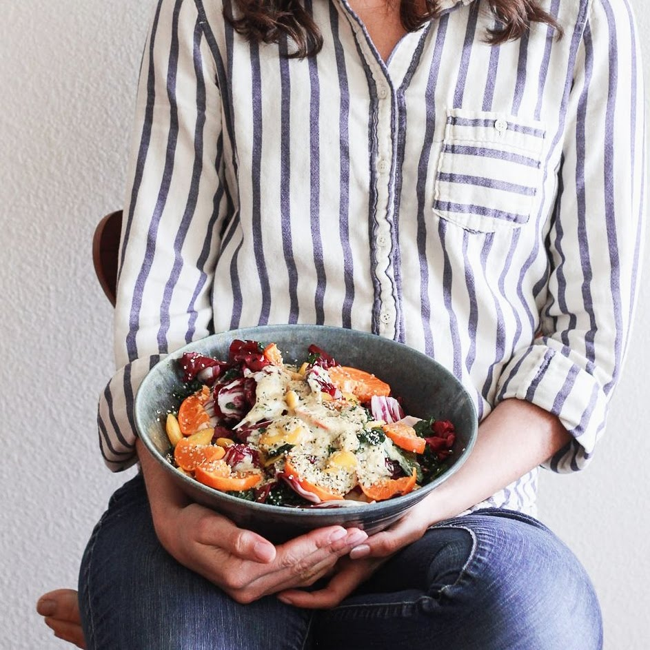 Lily Holding Citrus and Radicchio Salad
