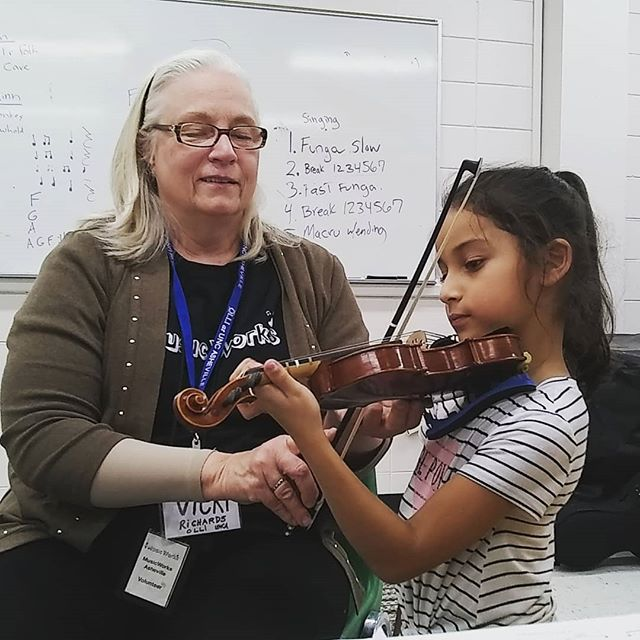 One of our fantastic volunteers is helping our girl Abby work on her violin skills. We really appreciate the volunteers that work with our students regularly and give their time to our program! #elsistemainspired #musicworks #violin #asheville #volunteersrock