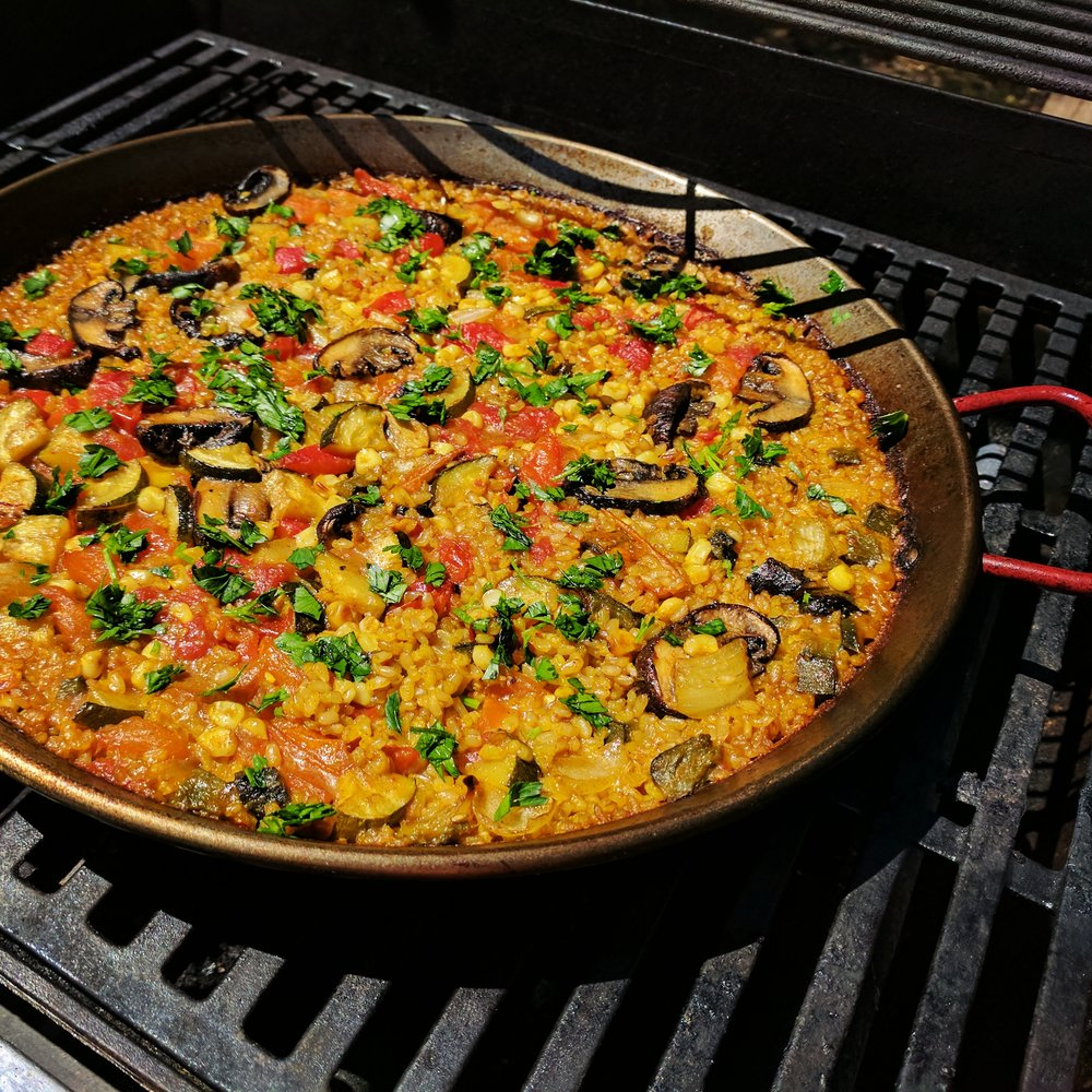 Cast-iron skillets, paella pans, and other high-heat pans can go directly on the grill. Make sure your pan is oven-safe and be sure not to touch the handles without oven mitts.
