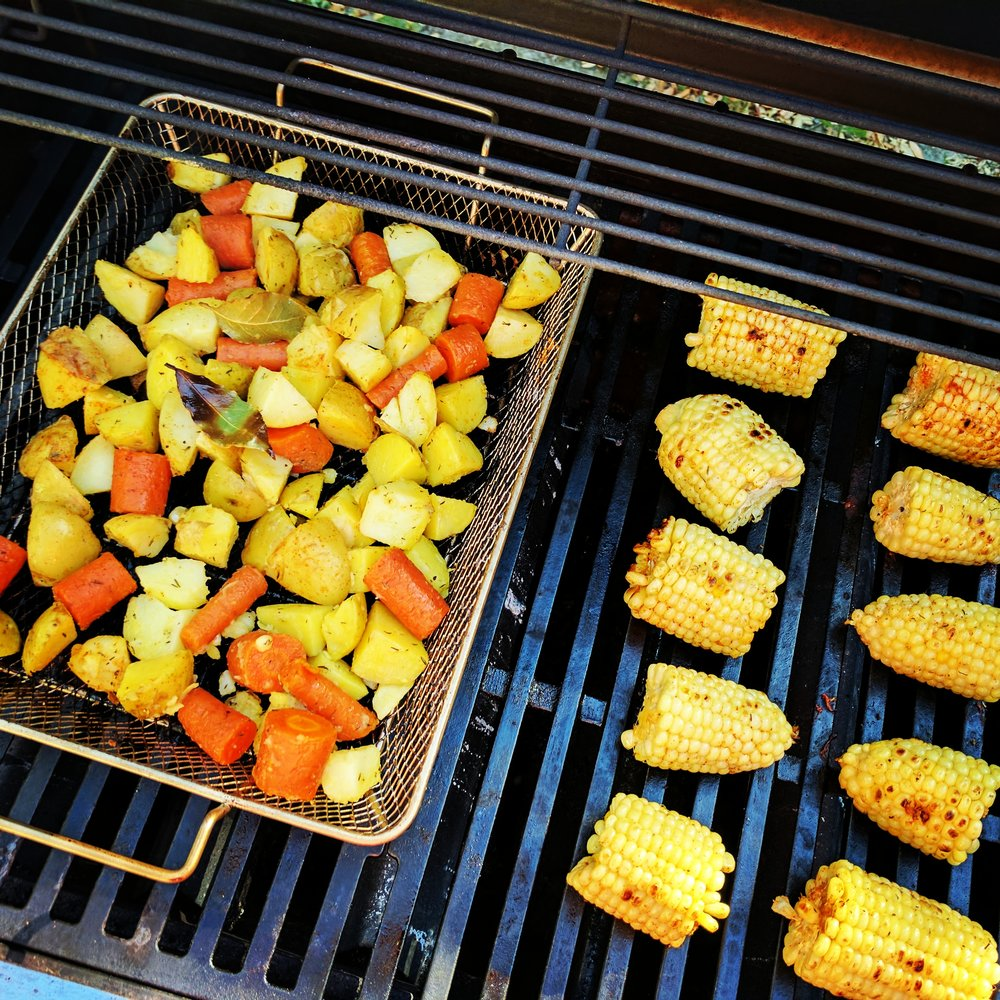A grill basket works well for chopped vegetables and functions like a roasting pan in an oven.