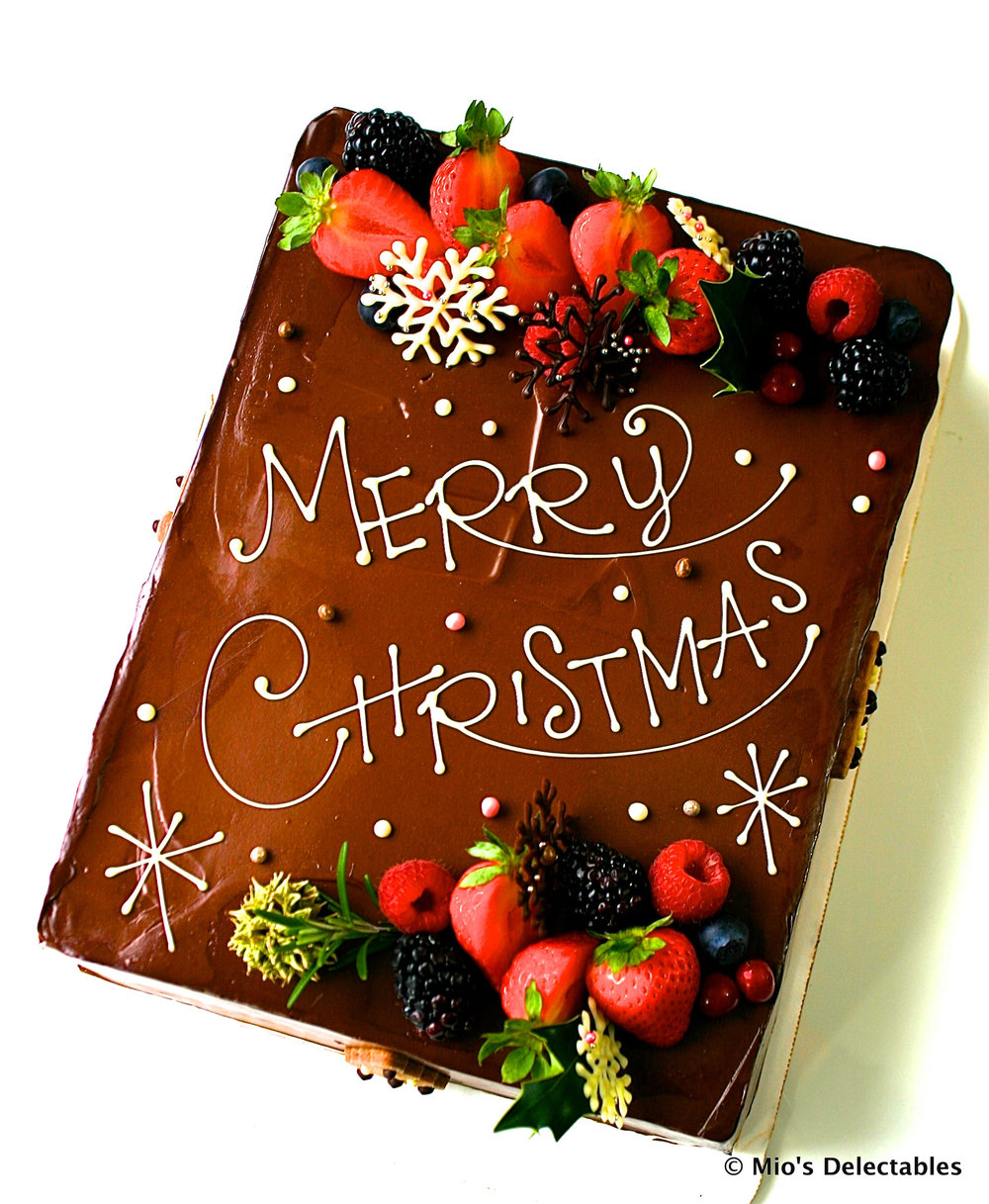 """SOLD OUT  *MIO'S DELECTABLES JAPANESE STYLE CHOCOLATE CHRISTMAS SHORTCAKE *1/8 Sheet Strawberry Short Cake (9"""" x 6"""") (23cm x 15cm) Chocolate $60 *1/4 Sheet Strawberry Short Cake (9"""" x 12"""") (23cmx 30cm) Chocolate $105  https://www.miosdelectables.com/christmas-cake-preorder/mios-delectables-japanese-style-chocolate-christmas-cake"""