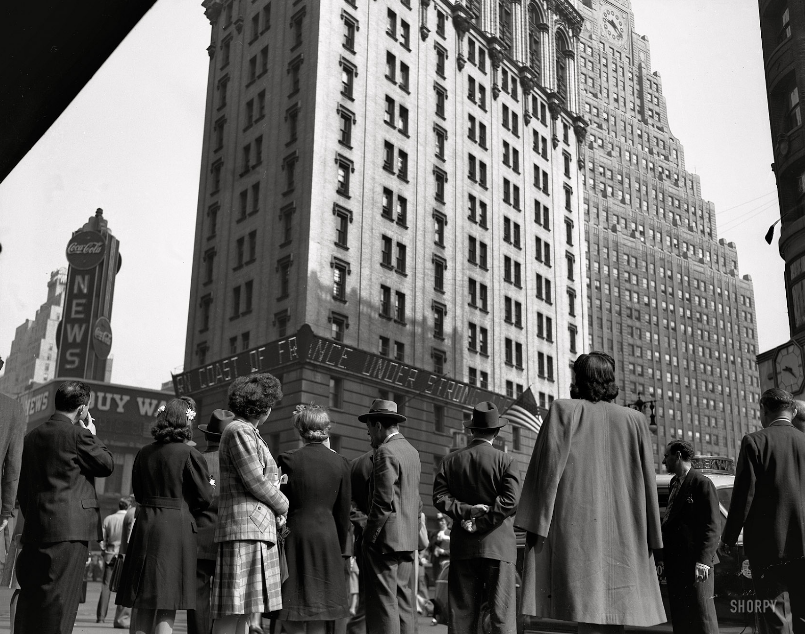 """""""The Zipper."""" New York, June 6, 1944. ALLIED ARMIES LAND ON COAST OF FRANCE. GREAT INVASION OF CONTINENT BEGINS. """"D-Day. Crowd watching the news line on the New York Times building at Times Square."""" Photo by Howard Hollem or Edward Meyer for the Office of War Information.  http://www.shorpy.com/node/6252"""