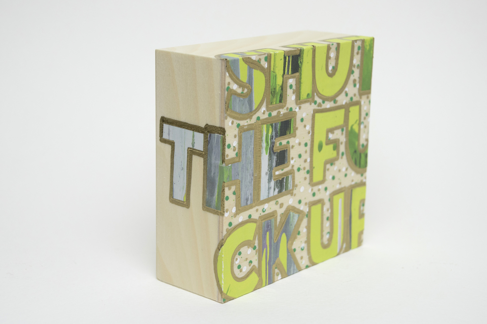 Shut The Fuck Up , 2016 Acrylic, enamel, felt tip marker and catalog pages on wood 4 x 4 x 1 5/8 inches