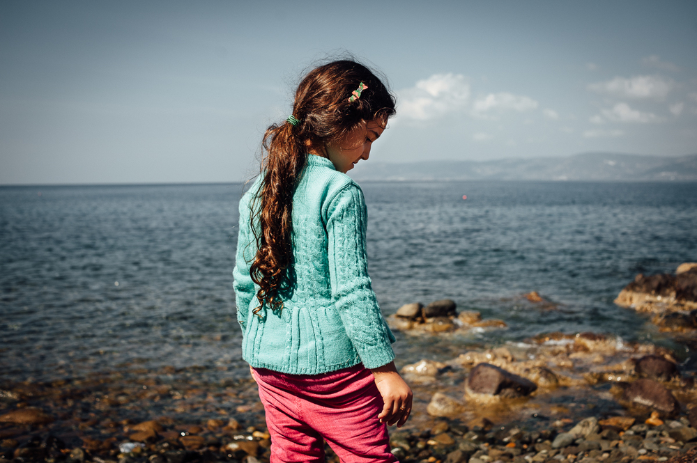 Mariam, a 6-year old Syrian refugee just after having crossed the sea between Turkey and Greece with her twin brother and mother. Oct 3, 2015.