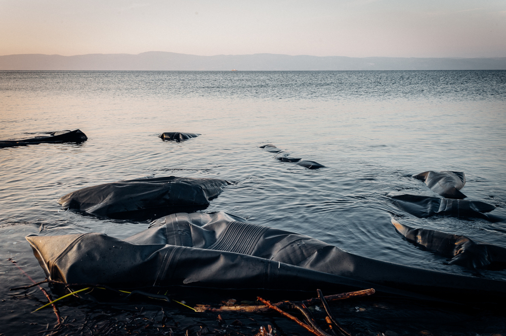 Torn up rubber dinghies, which refugees have used for a dangerous sea journey between Turkey (on the horizon) and Greece.  Oct 3, 2015.