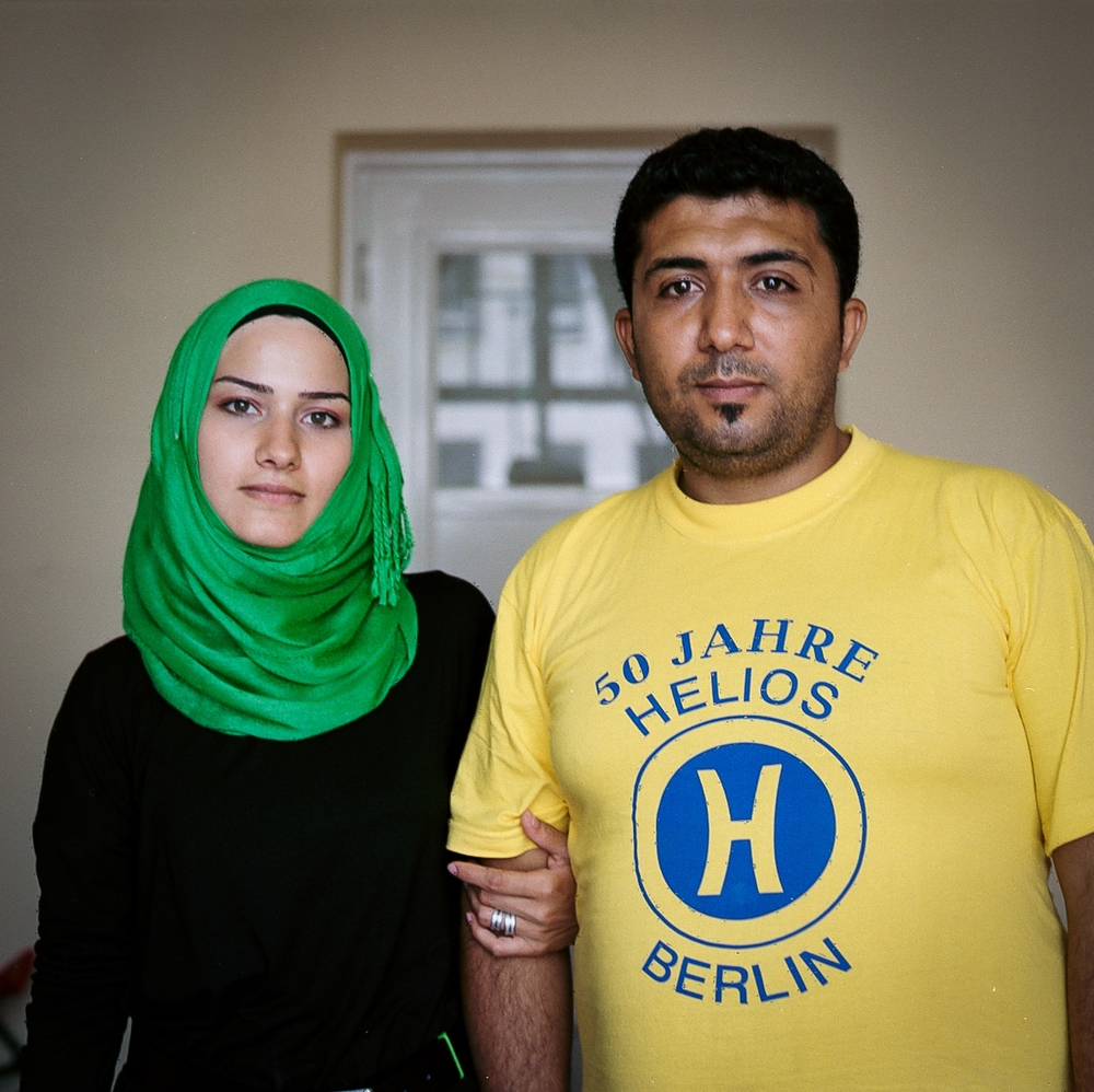 Nahed, 24, and Hassan, 32    In Aleppo, Hassan owned a toy store, and Nahed worked in a shop. Life was already hard without water and electricity due to the fighting and destruction of the city, but things got worse in July 2015, when during Ramadan, the different forces fought in Aleppo every night. Nahed and Hassan decided to take their two small children and leave Aleppo. Their journey to Germany took them 22 days, and many nights they slept on the streets. In the Hungarian camps their children, 4 and 7, were separated from them for two days and placed in separate cells. The Hungarian guards threatened Nahed to take her hijab away if she did not let herself be fingerprinted. For Hassan the hardest thing about leaving home was to say farewell to his parents. Syria is their home, but Hassan says that now the most important thing is the future of their children. August 19, 2015.