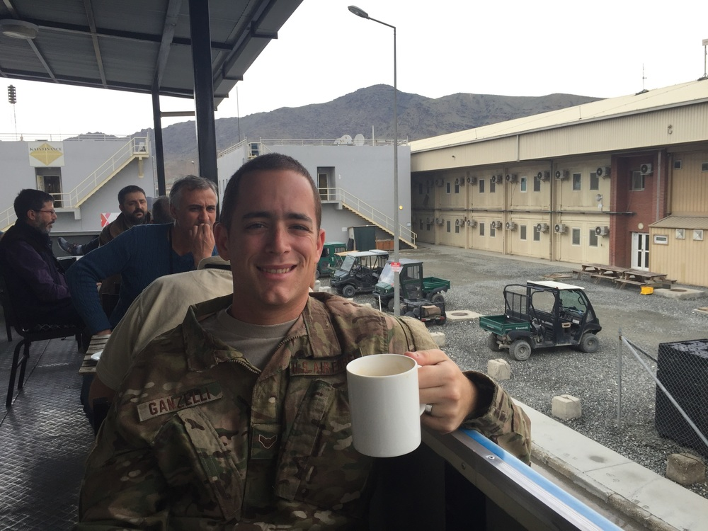 """Enjoying a great cappuccino at """"Tim's,"""" a coffee house on the base in Afghanistan."""
