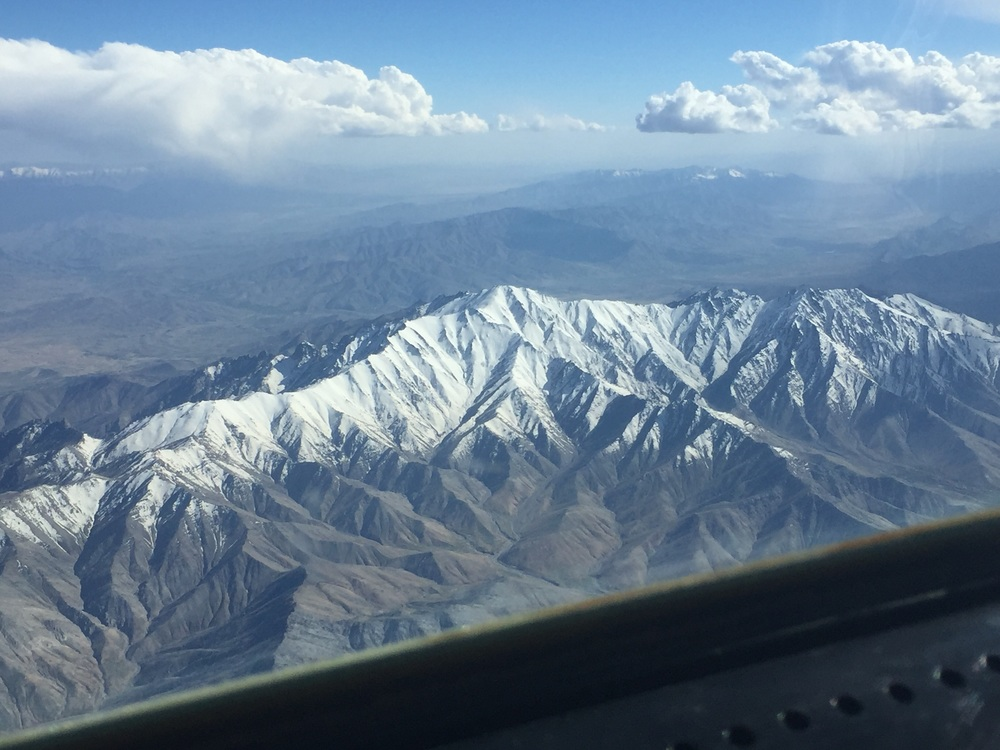 The view from the cockpit, flying over the snow-capped mountains of Afghanistan.