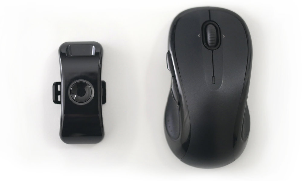 LightMode controller (left) next to a computer mouse (right) to demonstrate relative size.