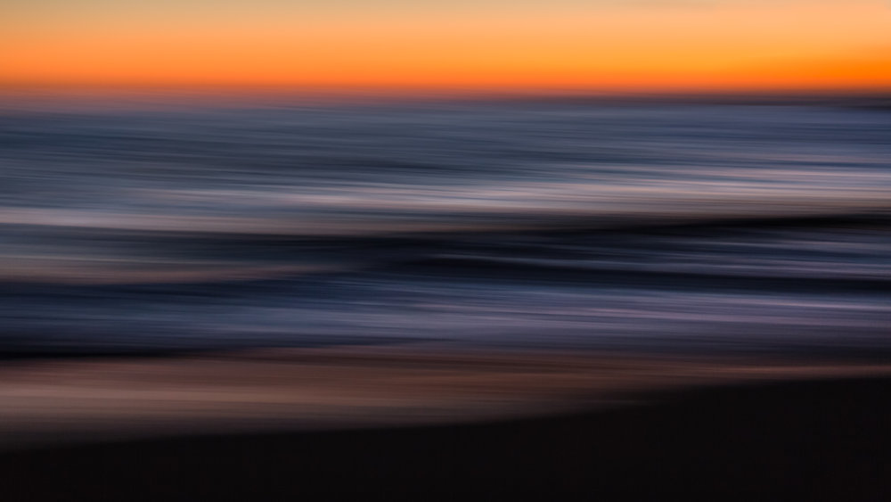 Canon EF70-200mm f/2.8L IS II USM, ISO 250, 70 mm, f/2.8, 0.4 sec. Ocean waves at dusk (California). Sideways pan. Polarizer.