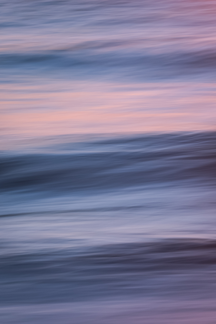 Canon EF70-200mm f/2.8L IS II USM, ISO 50, 200 mm, f/22, 0.5 sec. Ocean waves at sunset (California). Sideways pan. Polarizer.
