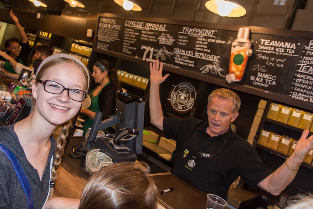 Happy Maggie and a boisterous server, TheOriginal Starbucks, Seattle WA.
