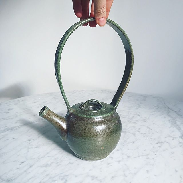 "This is a little teapot I made in 2002 at HACC, a local community college. Students just found out that their ceramics, glass blowing and screen printing classes are no longer going to be offered there. I can't begin to explain how this breaks my heart. When I was a young student, these classes helped me find my way. 💔 • The ceramics classes obviously had the biggest impact on me. We weren't just learning the technical skills to make pretty pottery, we were also learning about design. Line weight, movement/gesture, proportions, repetition of forms, continuity- the language and constructs of design that can be applied to many other disciplines like architecture, advertising, photography, product design, etc. I actually found all of this so fascinating that I stopped taking ceramics classes and went on to get my BFA in graphic design. Today I work as the creative director for @theburgnews. It is a community magazine that means so much to me. • In my advanced ceramics classes we also studied sculptors and public art, which directly inspired me to co-found @sprocketmuralworks , a tiny organization that is responsible for 30+ mural projects in our community. (And we are just getting started.) • I basically owe my entire career path to the ceramic classes that are being removed from the curriculum. • The funny thing is I always missed clay, and for 12 years this feeling sat quietly in my heart, patiently waiting to be acknowledged. I had told myself that I was going to revisit pottery when I retired. But life changed and I decided I didn't want to wait anymore. • Exactly two years ago I signed up for an advanced ceramics at HACC. My professor, Jim, whom I had learned so much from is still teaching there. It meant so much when he warmly welcomed me back. I was nervous because I hadn't so much as looked at a wheel or clay in well over a decade. When I walked into the class on the first day, one of the sweetest students @maureenjoyce3594 said ""Jim has told us about you, we are so excited to learn from you"" and I almost cried on the spot. • The students started a petition to keep the classes. The link is in my bio ☝️ #savehaccarts"