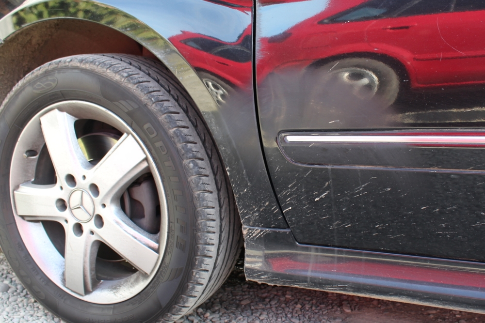 Damage caused by automatic wheel brushes after a single use.