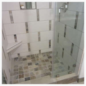 "An old fiberglass shower stall gets updated with a contemporary mix of glass, tile and slate. The slate was inserted as 2"" deco pieces on the walls, 4"" on the shower floor, and large 16"" on the bathroom floor."
