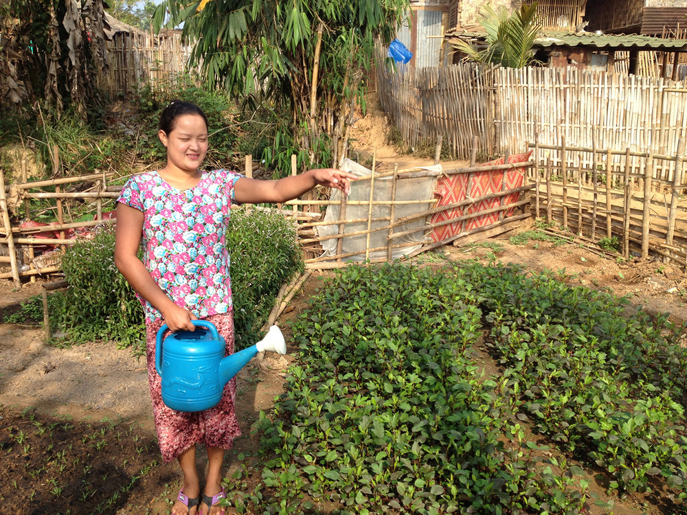 A local tending to her garden (Ban Mai community)