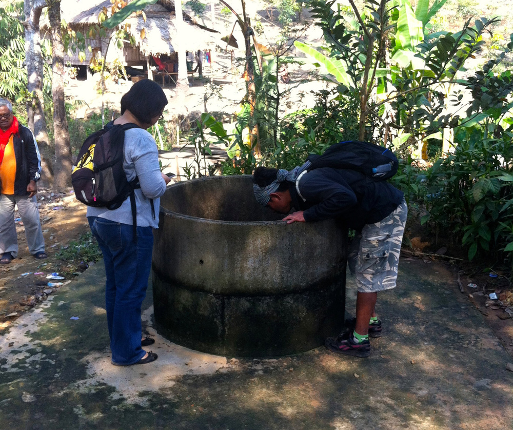 Checking out one of the wells that are water sources in Mong Sa Tur community