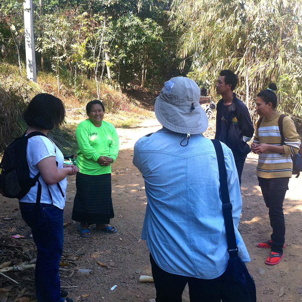 Talking to a health volunteer in Song Ka Lia community