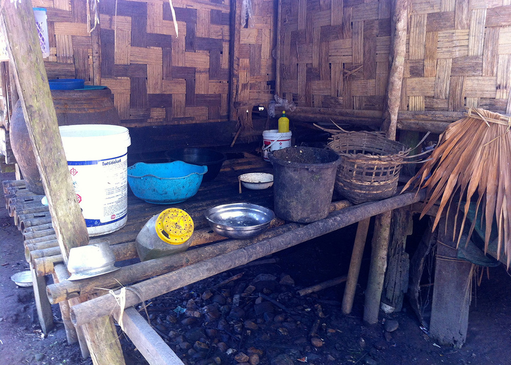 A typical kitchen area with water containers in Mong Sa Tur
