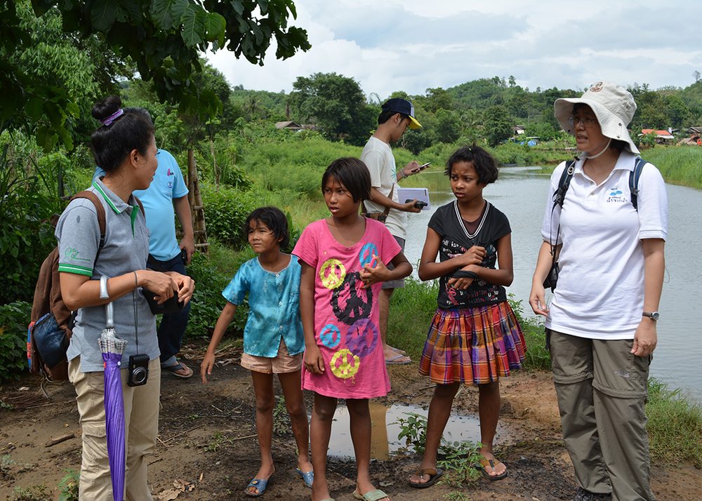 Talking to children in Ban Mai about their water situations during the rainy season