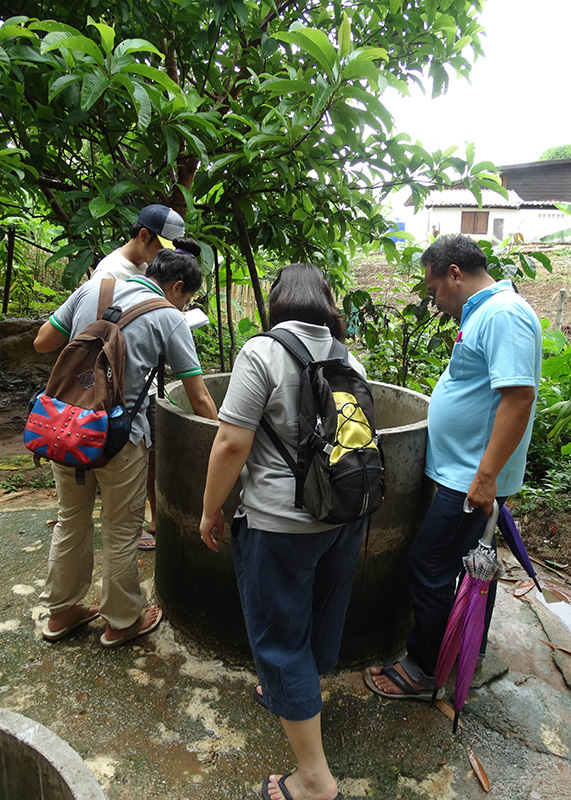Checking out a well in Mong Sa Tur