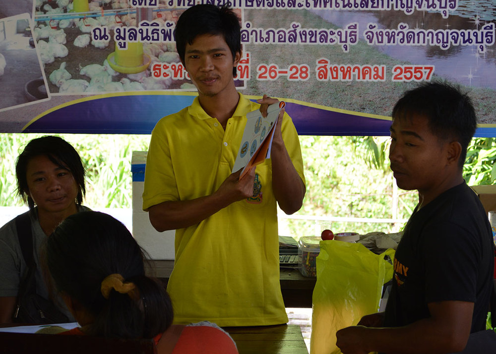 A participant presenting his ideas, while Daeng translating from Karen to Thai.