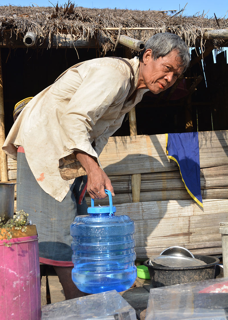 A man from another family in Fung Na showed us the drinking water he'd made that day. He told us that he liked to use the disinfected water, which was quite warm, to make coffee at the end of the day.