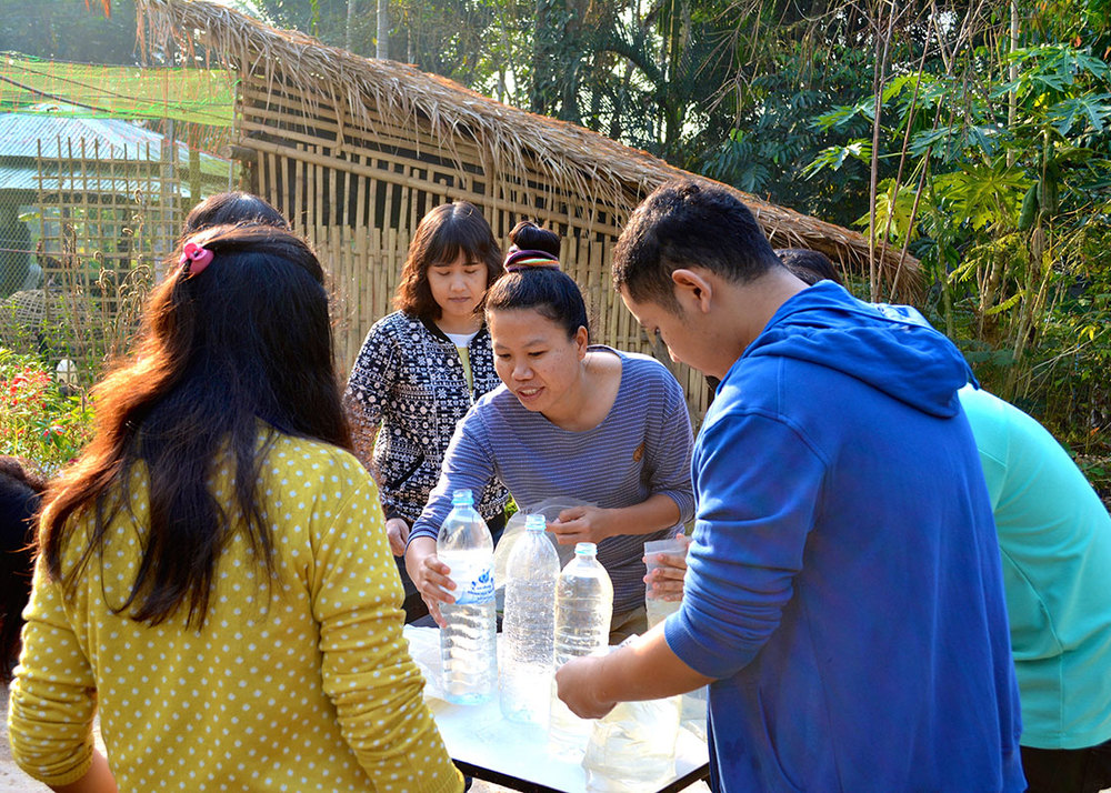 Piyawan showed the MTEC team members how to set up the daily experiments for the disinfection efficacy and material safety studies.
