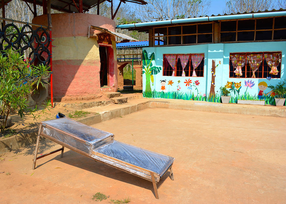 A prototype of a solar dryer was being used in front of the nursery school that the organization was starting.