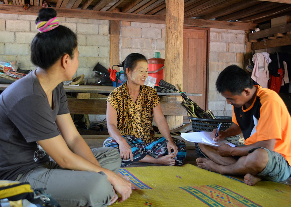 Taweeke and Piyawan interviewing another SODIS X user in Moraka community