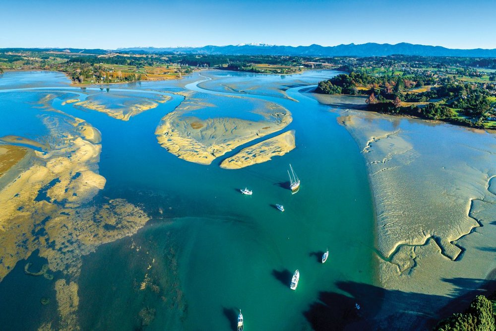 At low tide, the mudflats of Waimea Inlet rise above the water. This is the largest enclosed estuary in the South Island, and was affected by heavy sedimentation in the 1960s and 1970s, with 170 hectares of intertidal habitat lost. It's also an internationally significant area for migratory birds. Starting this year is a plan to increase saltmarsh area and reduce sediment contamination. ROB SUISTED