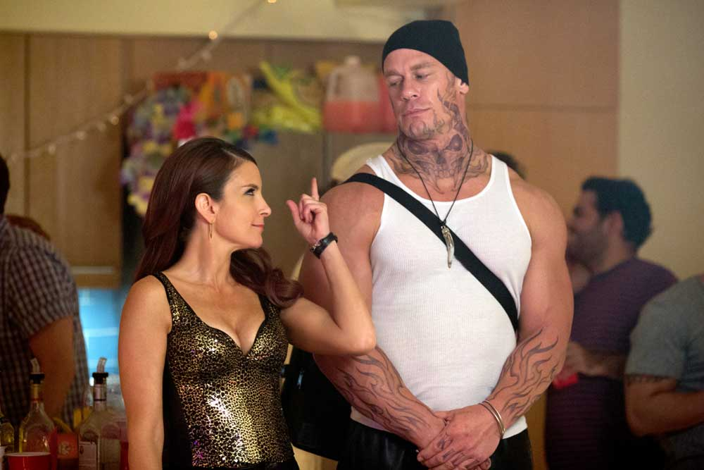Kate (Tina Fey) hits on drug dealer Pazuzu (John Cena) in SISTERS. K. C. Bailey / Universal Pictures
