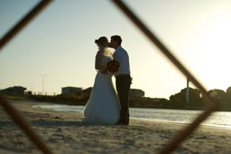 Beach weddings are very Australian. Here the couple enjoy a romantic kiss at Jurian Bay, Western Australia.